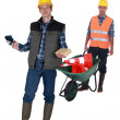 Stock Photo: Two men with masonry equipment