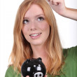 Young woman with a piggy bank — Stock Photo
