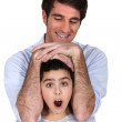 Man laying his arms over a surprised girl — Stock Photo