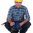 Foto Stock: Worker with circular saw