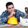 Royalty-Free Stock Photo: Tired tradesman about to smash his alarm clock