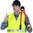 Worker with a pair of bolt cutters — Stock Photo