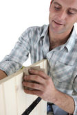 Furniture maker sanding wood — Stock Photo