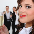 Business team drinking champagne — Stock Photo