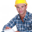 Portrait of worker writing in notebook — Stock Photo #13777708