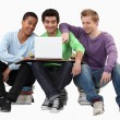 Young men looking at a laptop — Foto Stock