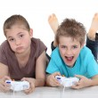 Stock Photo: Two kids playing video games
