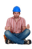 A construction worker in a yoga position. — Stock Photo