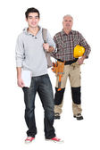 Student and woodworker — Stock Photo