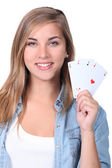 Young girl holding playing cards — Stock Photo