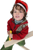 Little boy playing with wooden planks — Stock Photo