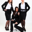 Stock Photo: Three seductive businesswomen