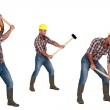 Tradesman laboriously using a mallet — Stock Photo #13781440