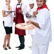 Italian pizza chef and restaurant staff - Stock Photo