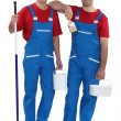 Stock Photo: Two decorators dressed in exact same outfit