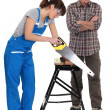 Female apprentice sawing wood - Stockfoto