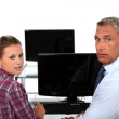 Teacher and student in front of computer — Stock Photo #13782895