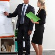 Business executives standing at a white board — 图库照片