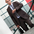 A businessman climbing stairs to his appointment. — Stock Photo