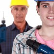 Man and woman with drills — Stock Photo #13783369