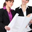Two women holding plans — Stock Photo #13783474