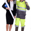 Female architect stood with manual worker — Stock Photo