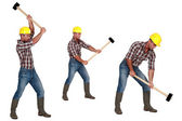 Tradesman laboriously using a mallet — Stock Photo