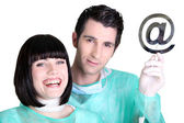 Doctors holding up the at symbol — Stock Photo