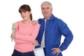 Man and woman ready for painting — Stock Photo