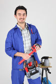Man stood with wrench and blow torch — Stock Photo