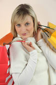 Blonde woman with bags — Stock Photo