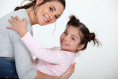 Mother and daughter playing — Stock Photo