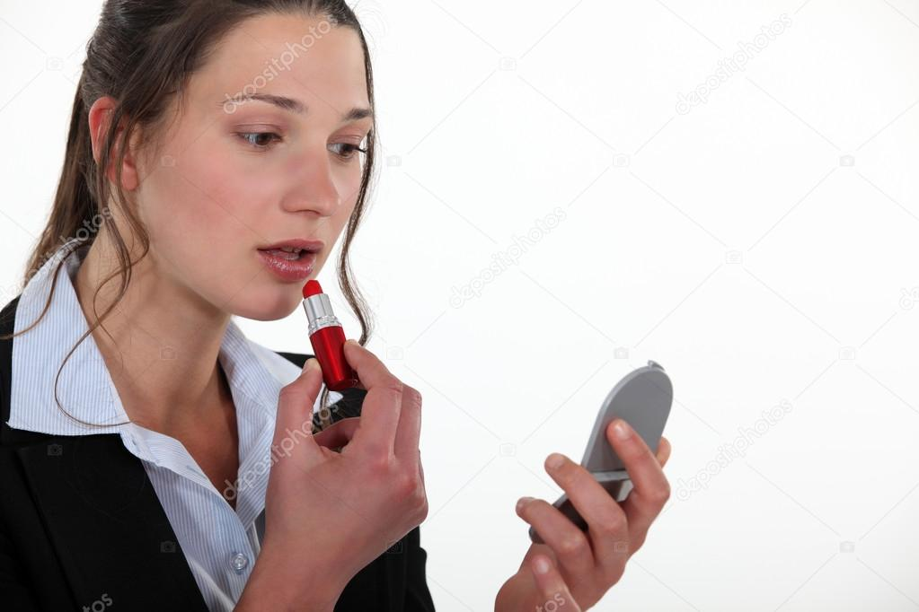 Woman putting lipstick on — Stock Photo #13781243