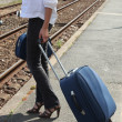 Woman waiting on a train platform with a suitcase Delaire_Constance_150410 — Foto de Stock