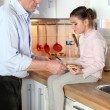 Stock Photo: Granddad and granddaughter in kitchen
