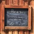 Restaurant menu written on a chalk board — Stock Photo #13828333