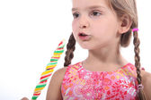 Young girl eating candy — Stock Photo