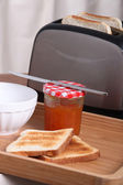 Toaster with jam and toasted bread — Stock Photo