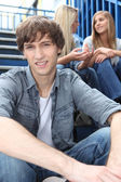 Teenagers sitting on the steps — Stock Photo