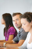 Colleagues sitting in a row — Stock Photo