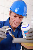 Plumber gluing plastic pipe — Stock Photo