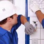 Electrician watching plan — Stock Photo