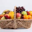 Wicker basket full of fresh fruit — Stock Photo