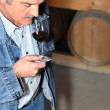 Stock Photo: Mtasting wine in storehouse Soumet_JJacques_140410