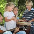 Stock Photo: Portrait of a family playing music