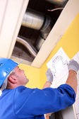 Engineer examining ventilation system — Stock Photo