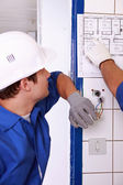 Electrician watching plan — Stock Photo