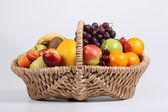 Wicker basket full of fresh fruit — Stock Photo