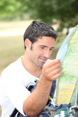 Man looking at map for directions — Stock Photo
