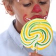 Little boy made-up sucking lollipop — Zdjęcie stockowe #13927687